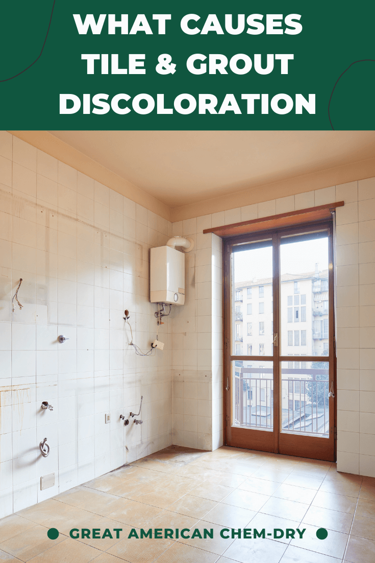 An image showing discolored tile and grout that asks the question, what causes tile & Grout discoloration