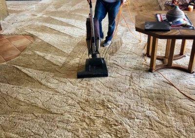 man vacuuming his carpets in San Diego